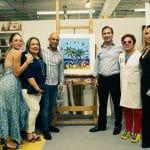 Nicolas Delrieu entrega pintura de Romero Britto al ex presidente de Haití Michel Martelly
